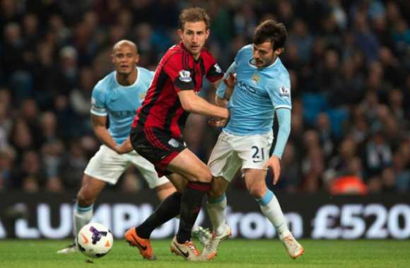 Craig Dawson, en train de balancer David Silva