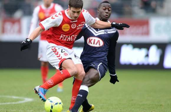 Florent Ghisolfi (Reims) contre Henri Saivet (Bordeaux)