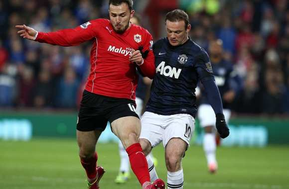 Jordan Mutch (Cardiff City) face à Wayne Rooney (Manchester United)
