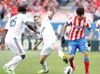Diego Costa (Atlético Madrid) à la lutte avec Angel Di Maria (Real Madrid)