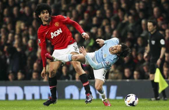 Marouane Fellaini (MU) face à David Silva (ManCity)
