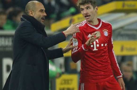 Pep Guardiola et Thomas Müller.