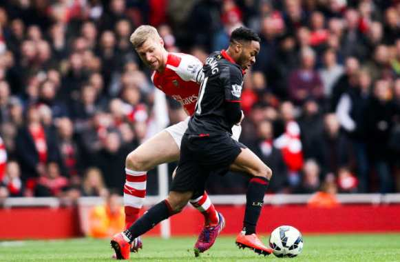 Per Mertesacker et Raheem Sterling