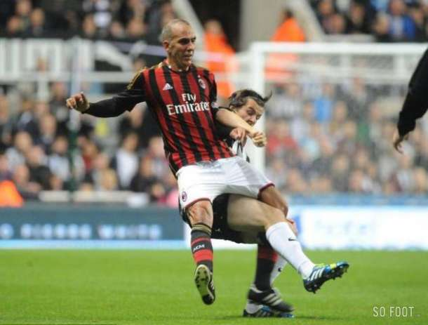 Thwack! Joey Barton upends Paolo Di Canio during Steve Harpers Testimonial