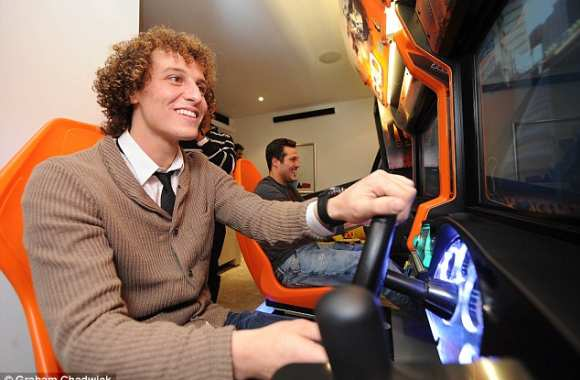Photo: David Luiz et Julio César en drivers