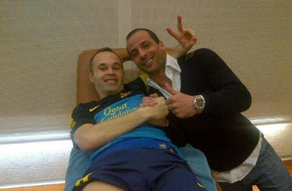 Photo: Iniesta avec Giuly au Camp Nou