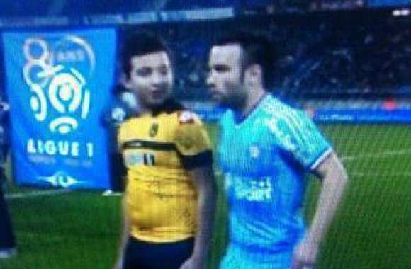 Photo : Valbuena et l'enfant
