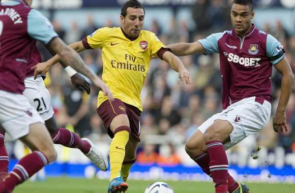 Santi Cazorla (Arsenal) entre McCartney et Reid (West Ham)