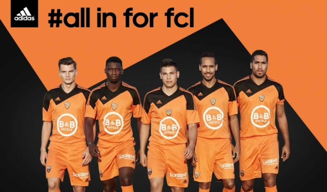 http://www.sofoot.com/data/sofoot_articles/187105/maillot-fc-lorient-domicile-2014-2015-adidas.jpg